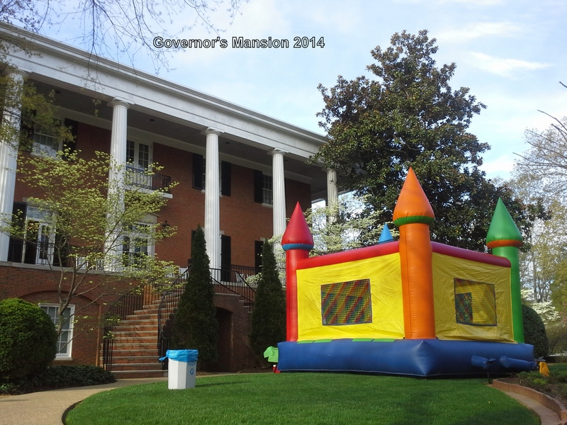 Jumpy Fun's Large Multi Colored Castle Moonwalk at Governor's Mansion